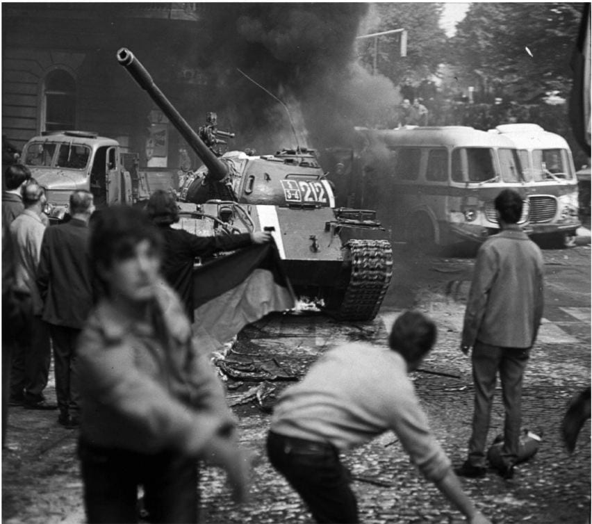 As the soviet-led invasion by the warsaw Pact armies crushed the so called Prague spring reform in former Czechoslovakia, Prague residents carrying a Czechoslovak flag and throwing burning torches attempt to stop a soviet tank, August 21, 1968.