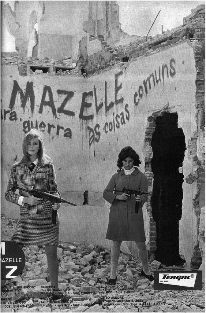 Two woman, about age 20 and fashionably dressed, hold guns in an advertisement.
