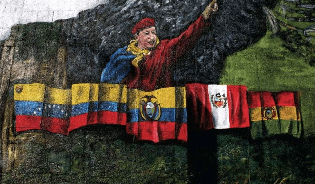 Mural depicts Hugo Chávez as the leader of Latin American unity., with flags from Columbia, Venezuela, Ecuador, Peru, and Bolivia below him.