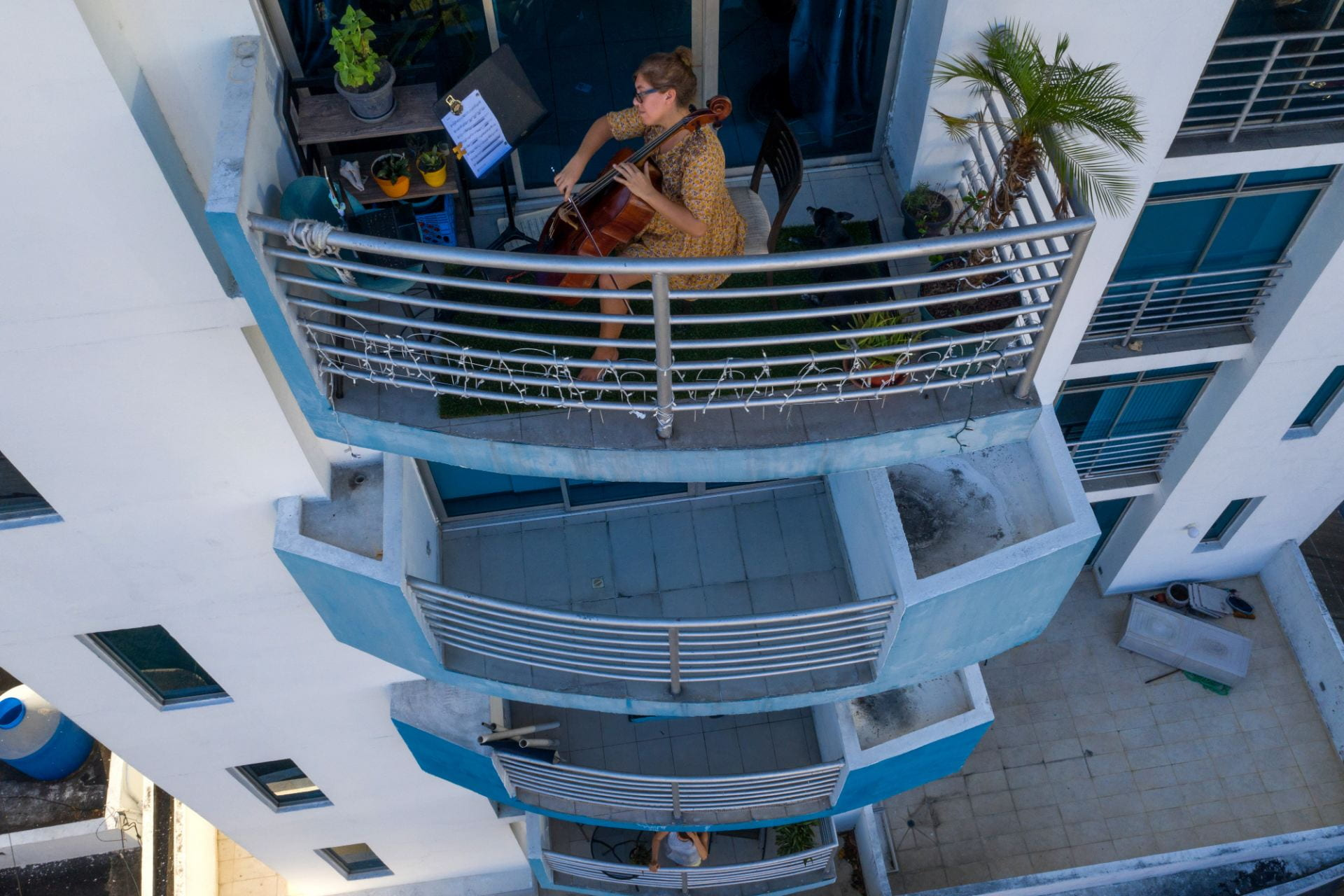 cellist Karina Nunez playing on the balcony of her apartment in Panama City