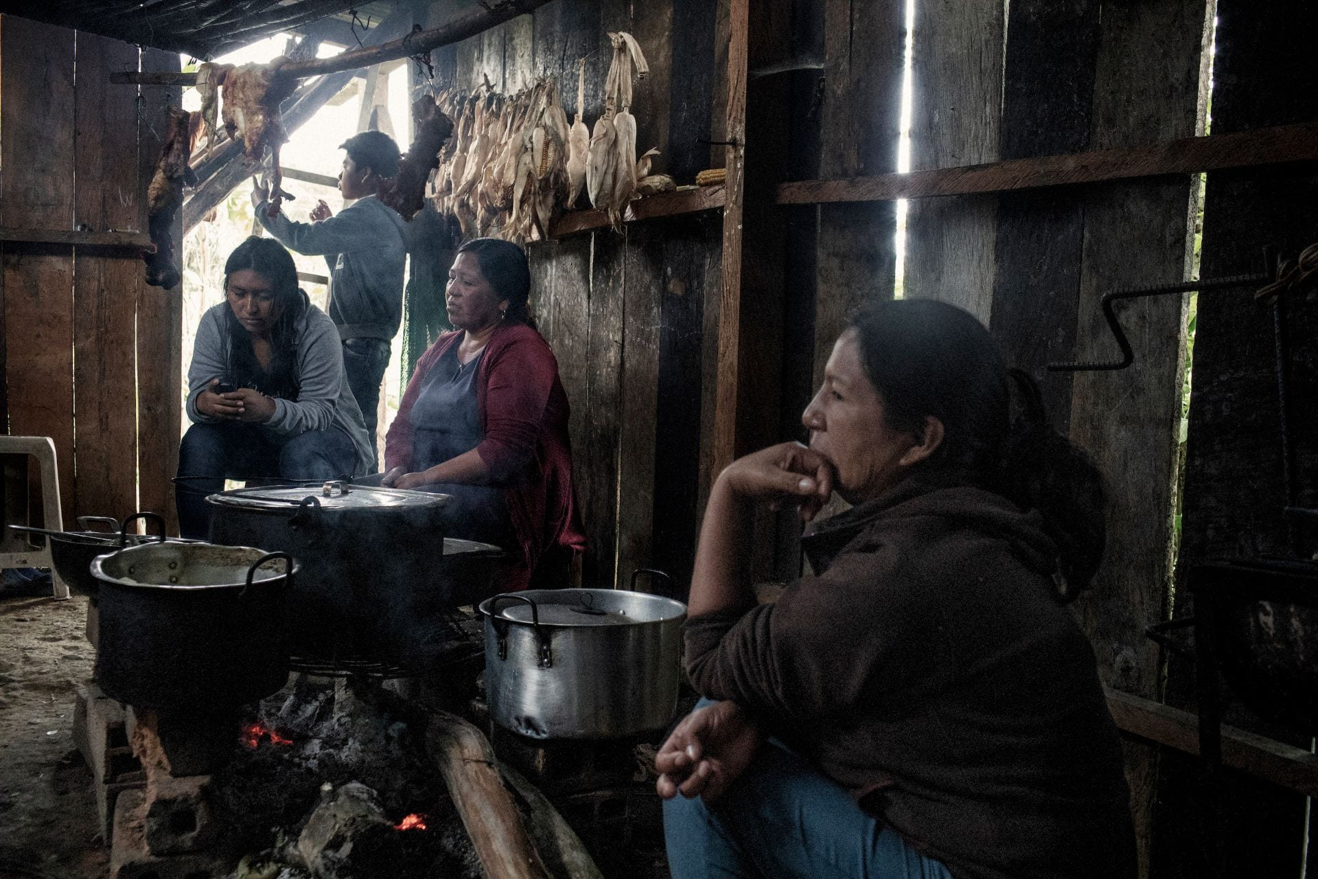 women cooking over wooden fire