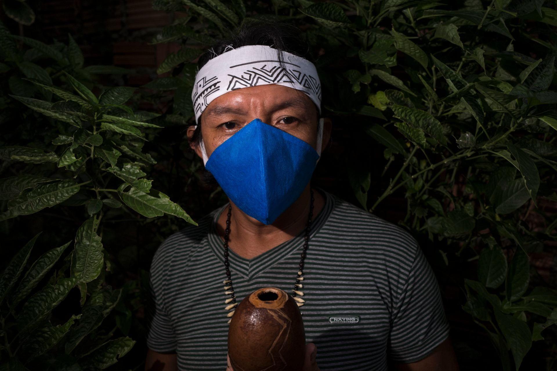 masked indigenous shaman