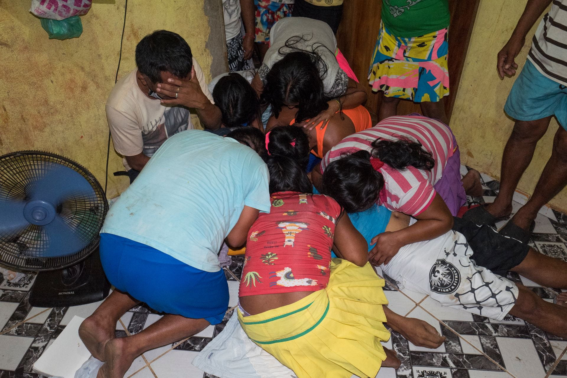 Relatives mourn the death of José Alirio, 45, who died of Covid-19 a few hours ago in a room of a community of about 150 Warao Indigenous refugees in Outeiro, a district of Belem do Pará, Brazilian Amazon. This is the fifht death by COVID19 withing the Warao people of Belém in the past month, including three children. More than xxx indigenous died during the Coronavirus outbreak in Brazil.