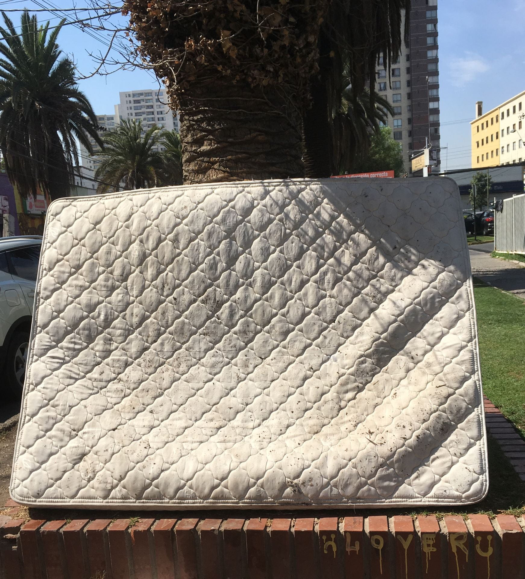 abandoned mattress in the street