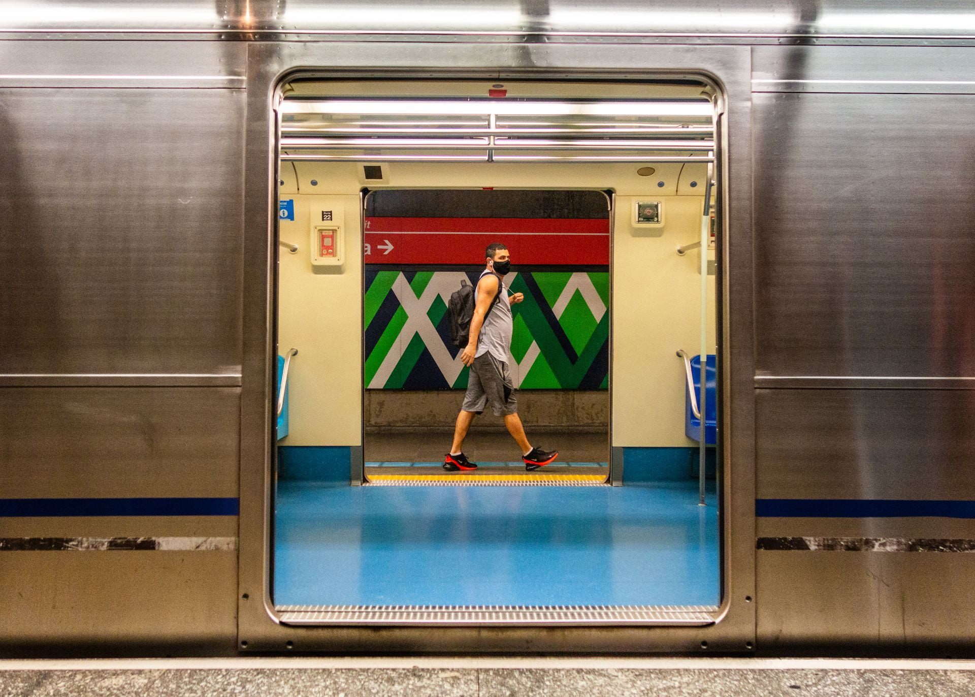 man seen through subway door