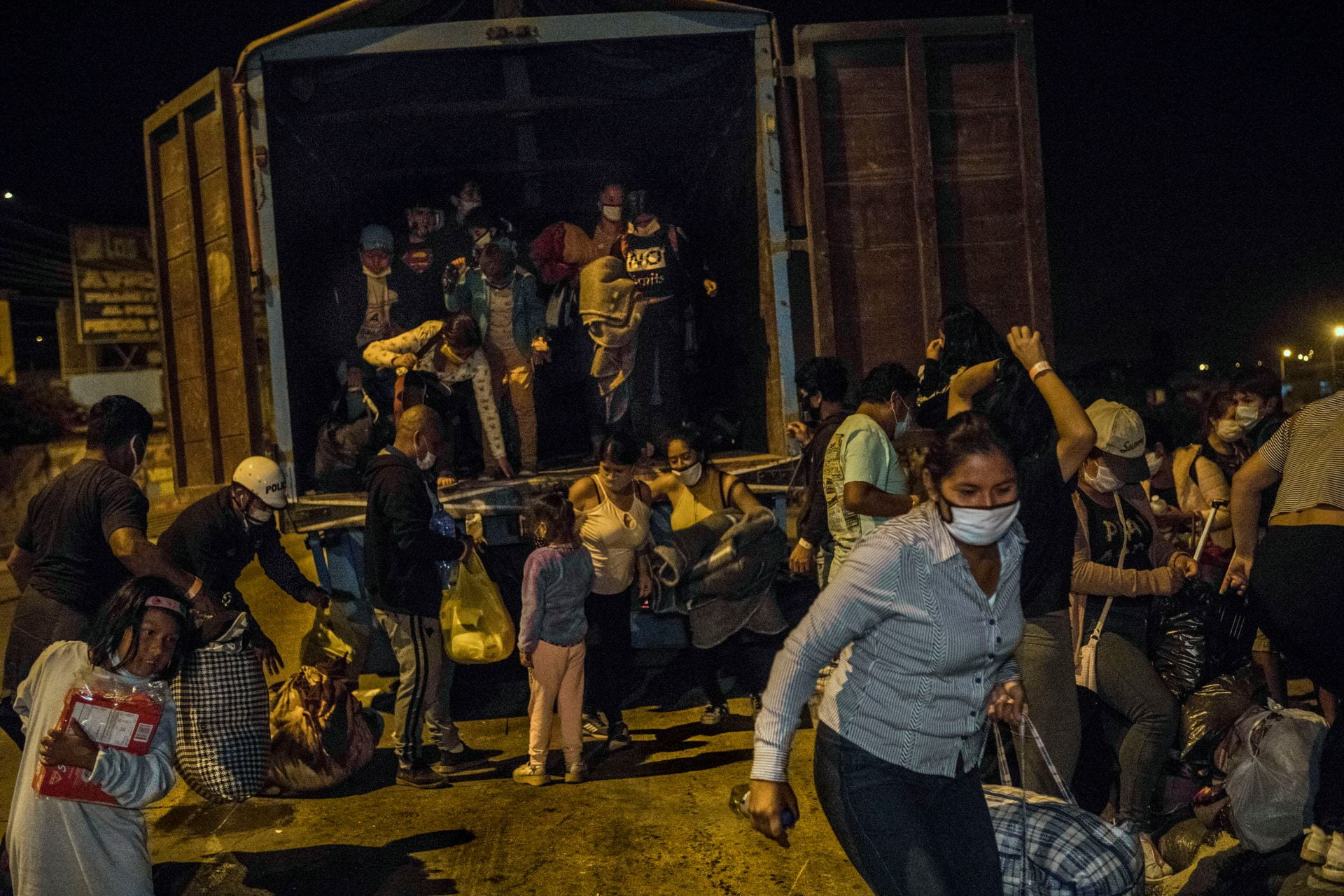 People fleeing Covid in container truck