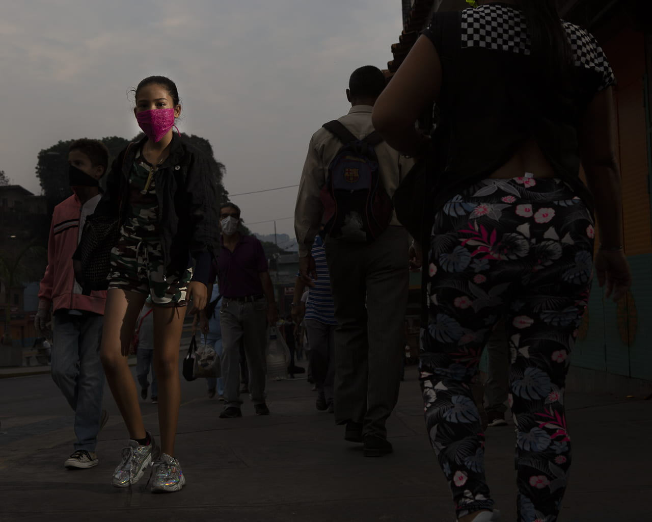 masked girl walking