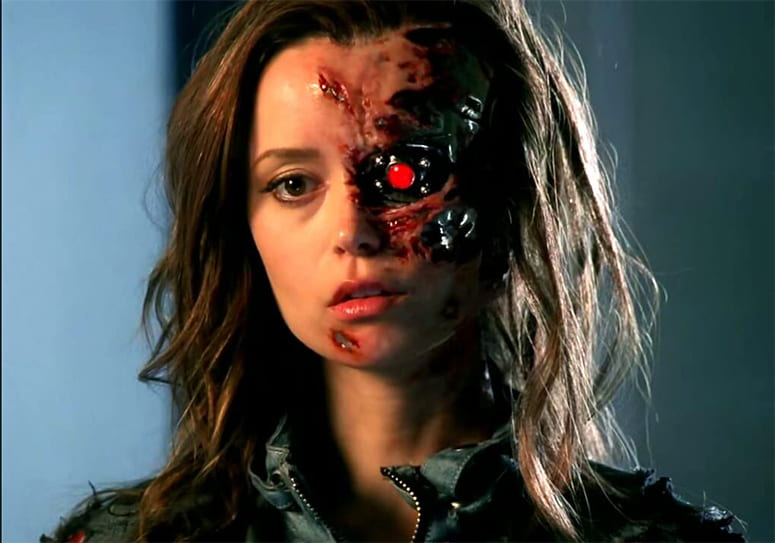 Actress Summer Glau as a terminator, with machinery exposed in her face.