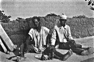Photo of two seated men