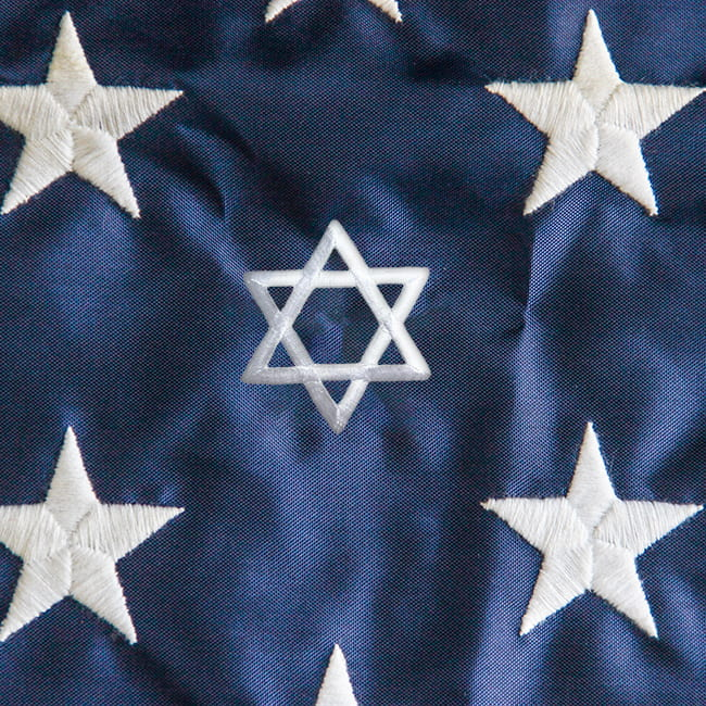 Detail image of the stars on an American flag, with one star replaced with the Star of David