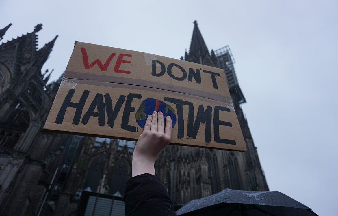 Protester holding a We Don't Have Time sign