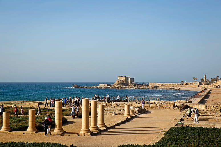 Photo of tourtists exploring the ruins at Caesarea