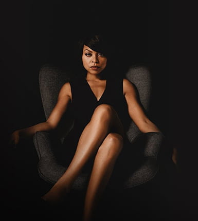 Taraji P Henson sitting in a chair