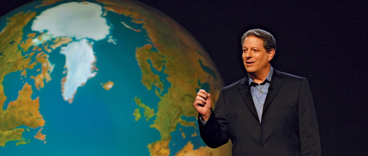 Al Gore standing in front of an image of the earth