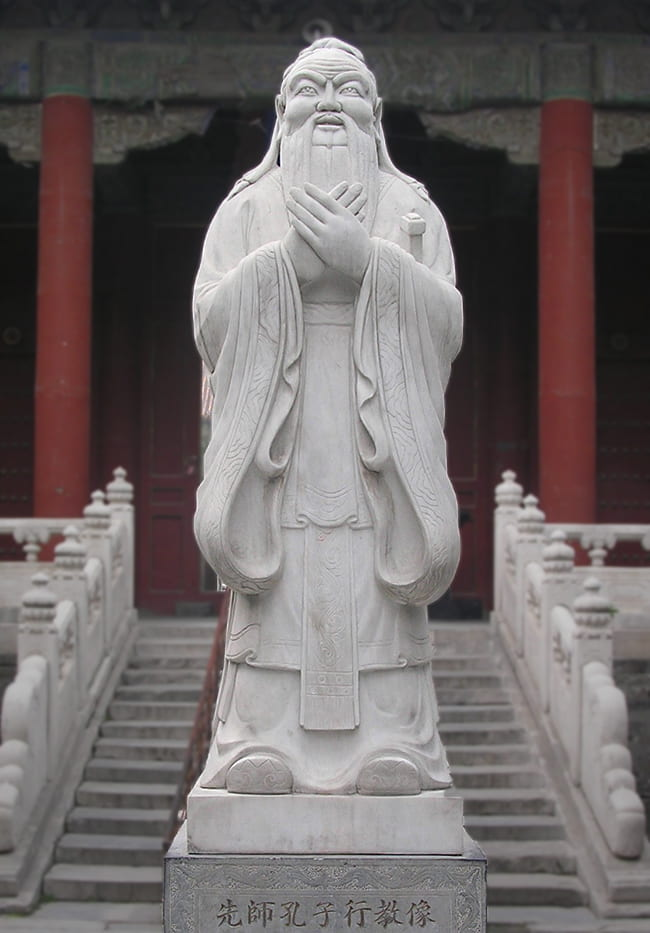 Stone statue of Confucius at the entrance to a temple
