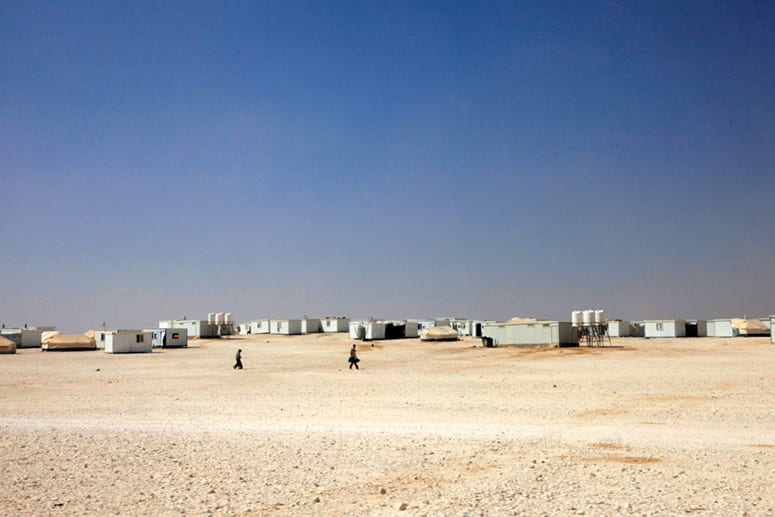 Photo of refugee camp temporary buildings in desert
