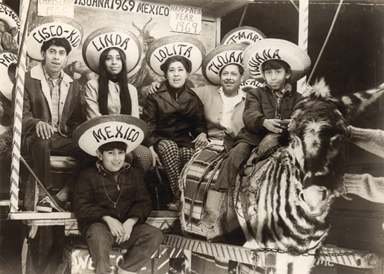 Photo of family seated together, wearing sombreros, celebrating New Years in 1969