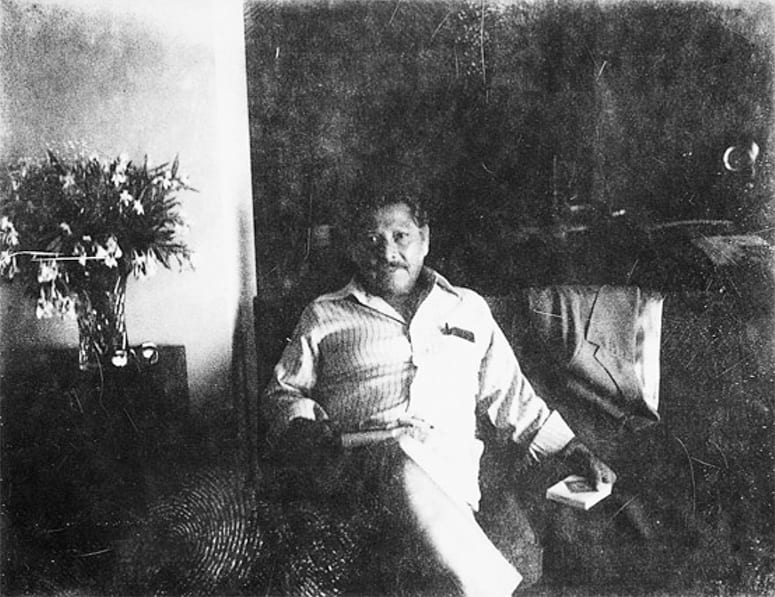 Faded photo of an old man resting in a chair