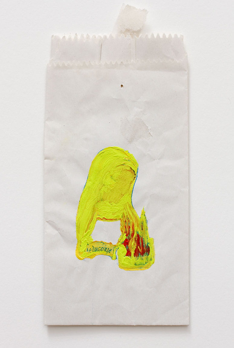 Gift shop bag with an image of Mary painted over in neon yellow