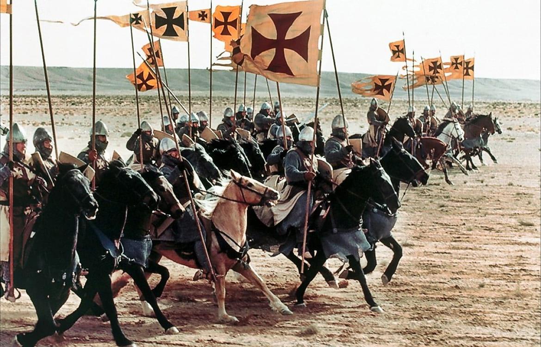 Film still of knights on horseback charging
