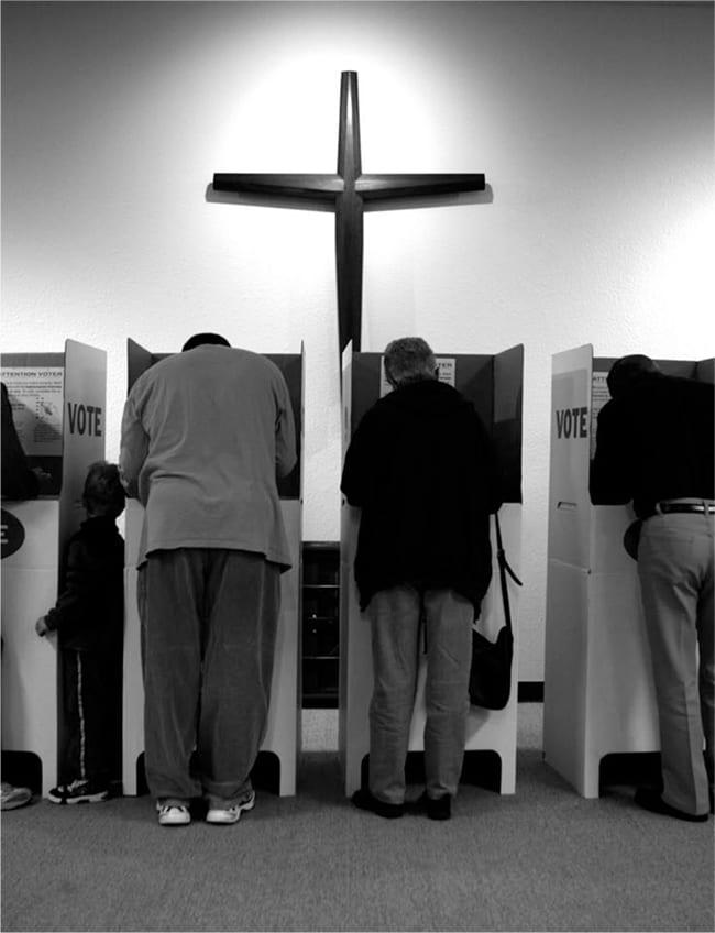 Voting booths under a church's cross