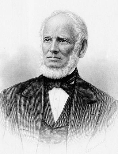 Engraving of bearded man in a suit