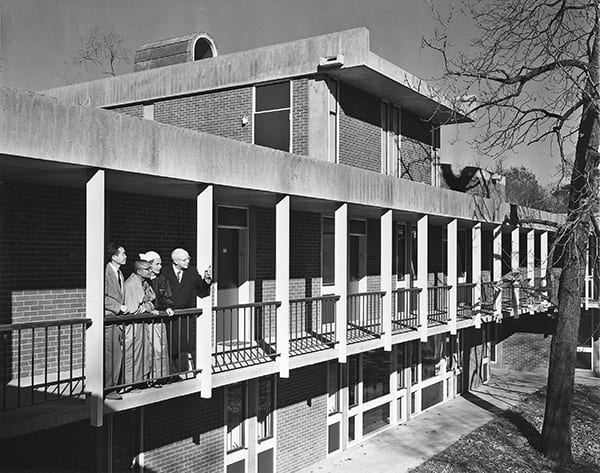 Slater and guests looking at the CSWR courtyard from the balcony