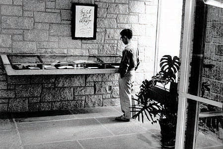 Student at the entrance to the Andover-Harvard Theological Library