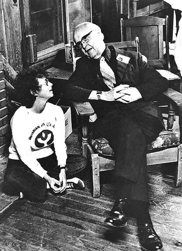 Photo of James Luther Adams talking to a student