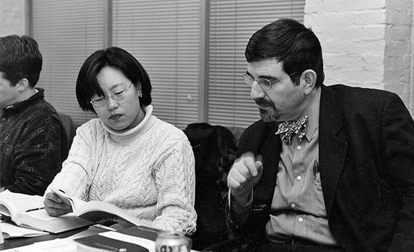 Jon Levenson sitting with a student