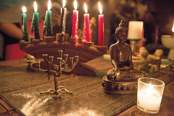 Candles and religious figures from multifaith service