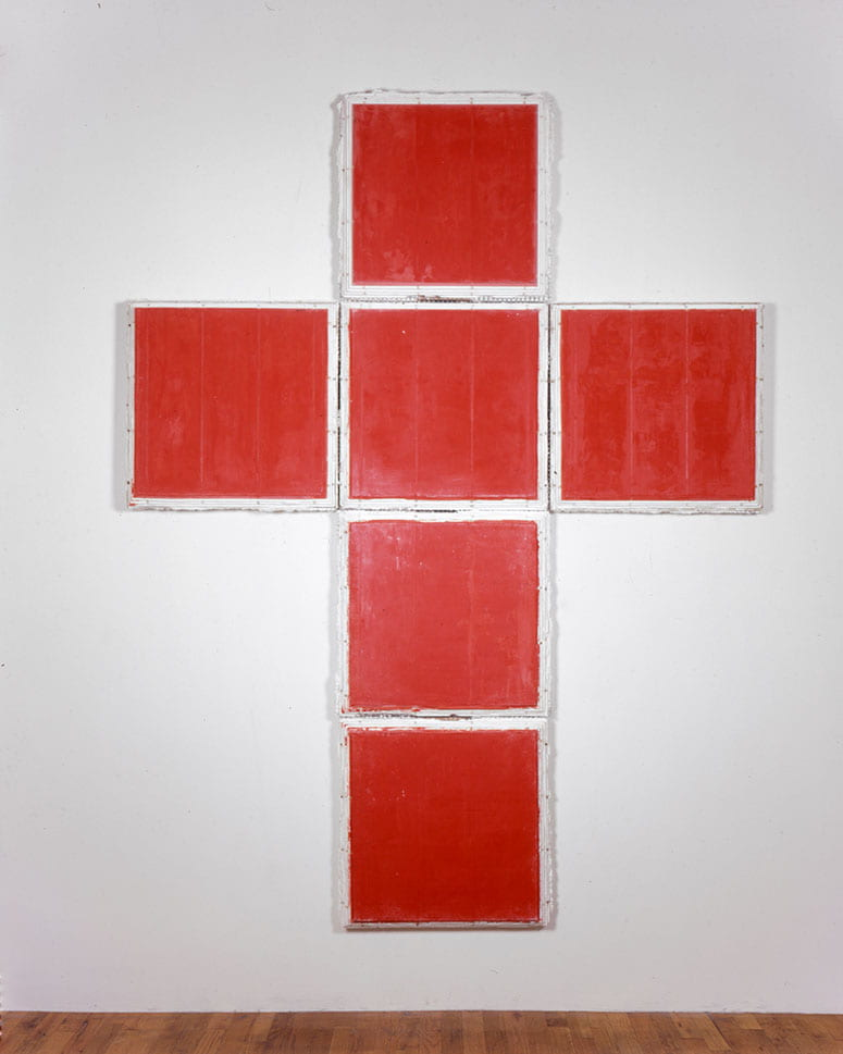Photo of a series of red squares showing the cross-like shape of an open cube