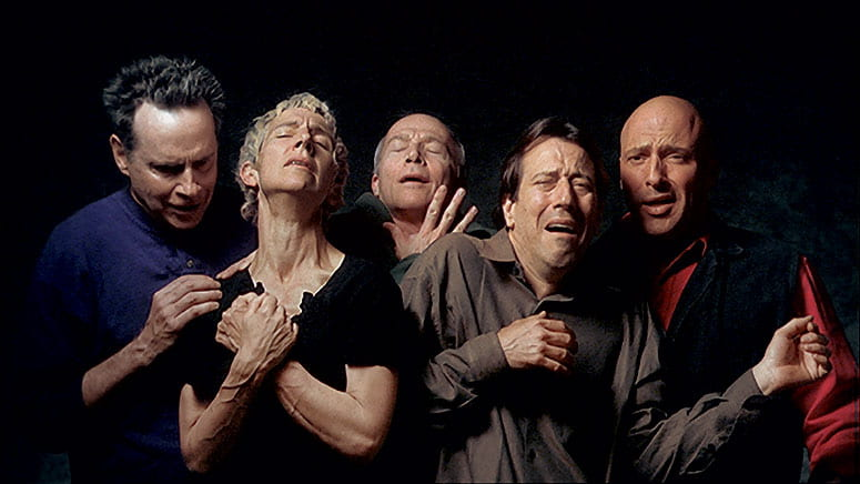 Photo of five people reacting with strong grief and wonder to witnessing the crucifixion