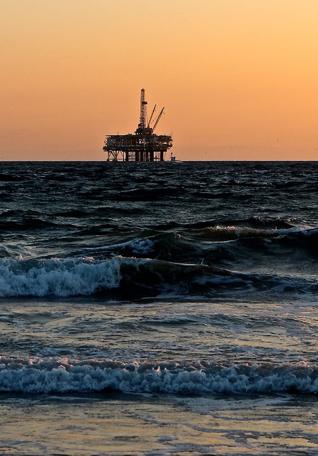 Oil Rig on the horizon in the Gulf Coast at dawn