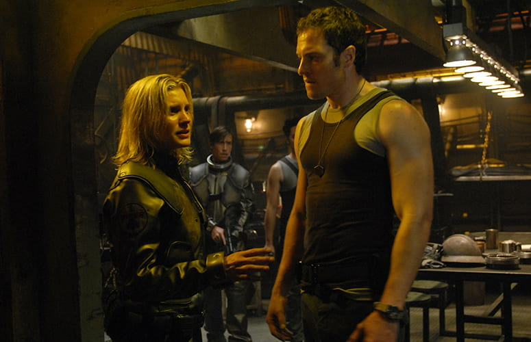 Still image of Starbuck and Captain Agathon in the mess hall