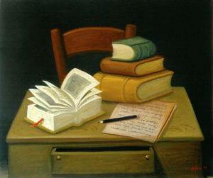 volumi su una scrivania, foglio e penna