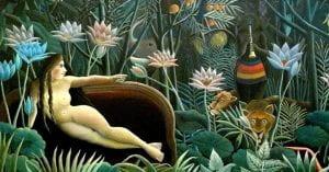 donna nuda sdraiata su un divano in mezzo a grossi fiori