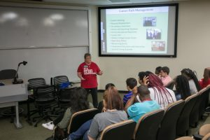TAP students learn about technology careers and salaries from Renee Clay, managing director of Walton's Career Services.