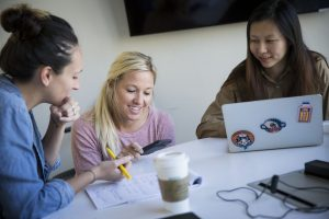 Walton College alum April Seggebruch, a co-founder of Bentonville-based Movista, mentors current students in the University of Arkansas' New Venture Development class. (l to r) Leslie Godwin, April Seggebruch, Xiaochi Ma. Photo credit: Garrett Hubbard Walton College alumna April Seggebruch, a co-founder of Bentonville-based Movista, mentors current students in the University of Arkansas' New Venture Development class. From left, Leslie Godwin, April Seggebruch, Xiaochi Ma. (Garrett Hubbard for the University of Arkansas)