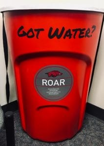 Red Solo cups (trash cans painted red) help draw attention to ROAR's Got Water? campaign on campus.