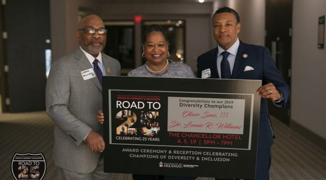 Barbara Lofton (center) presents Lonnie R. Williams, Ed.D., (left) and Oliver Sims III (right) with the Diversity Champions award on behalf of Walton College's Office of Diversity & Inclusion. [photo credit: Ryan C. Versey]