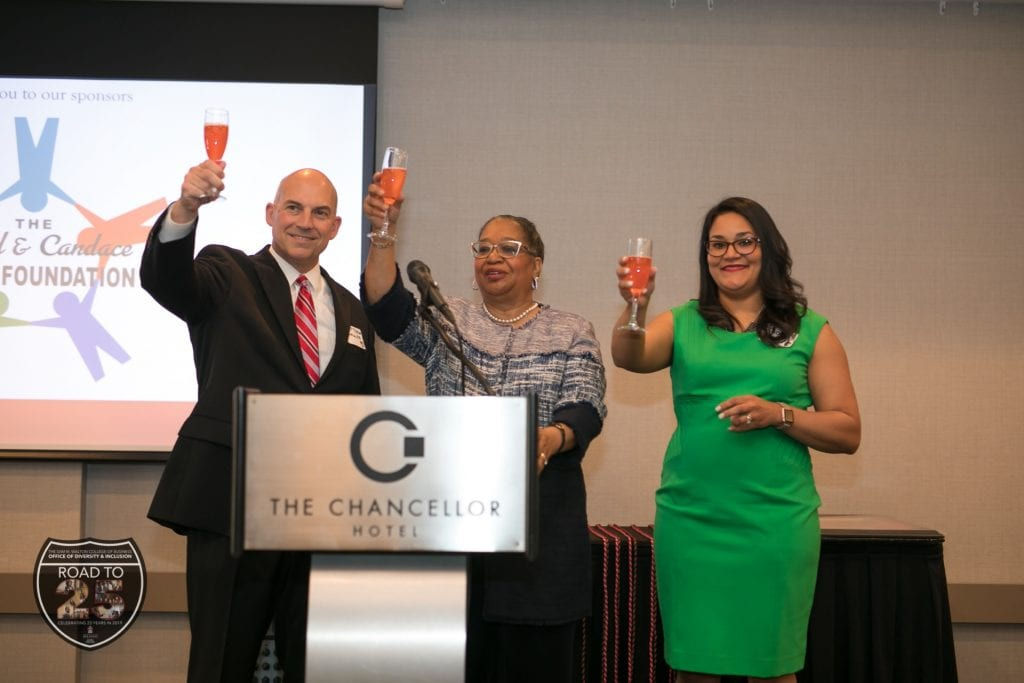 (l-r) Matt Waller, Barbara Lofton and Ebony Wyatt ask attendees to toast the Office of Diversity & Inclusion in honor of its 25th anniversary.