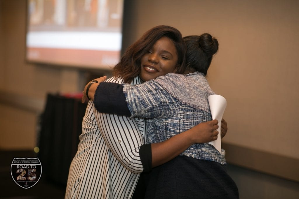 Keynote speaker De'Stani Clark, a marketing senior, hugs Barbara Lofton as she completes her speech.