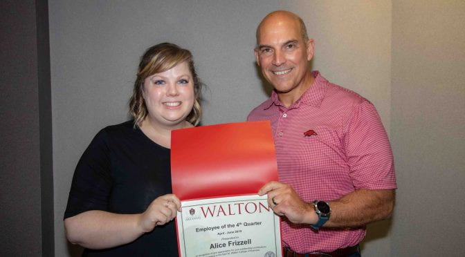 Dean Matt Waller recognizes Alice Frizzell as Employee of the 4th Quarter for Walton College.