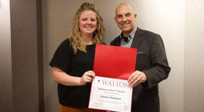 Dean Matt Waller presents Ashlee Shepherd the Employee of the Quarter award on behalf of Walton College.