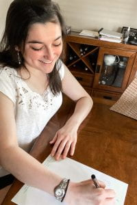 Walton sophomore Kaitlin Ketchey writes a letter for the initiative.