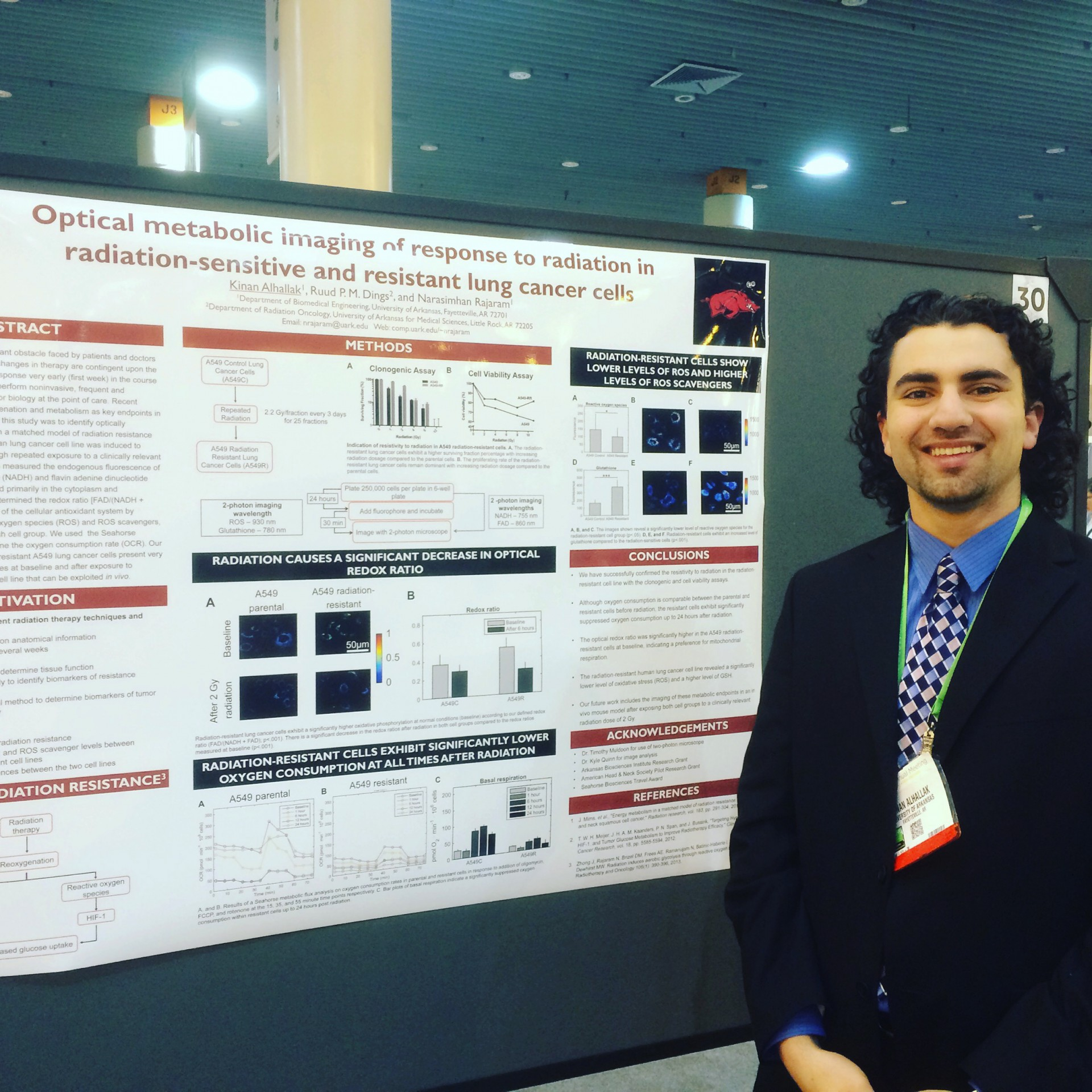 "Alhallak presents his research on ""Optical metabolic imaging of response to radiation in radiation-sensitive and resistant lung cancer cells."""