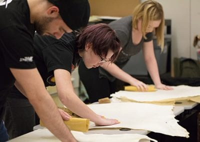 The students first had to sand down their skins to prep them for receiving ink. The class used sandpaper, but in the Middle Ages manuscript makers would have used sand, pumice, or a sanding loaf (powdered pumice or glass baked together with flour and brewer's yeast) to refine their skins.