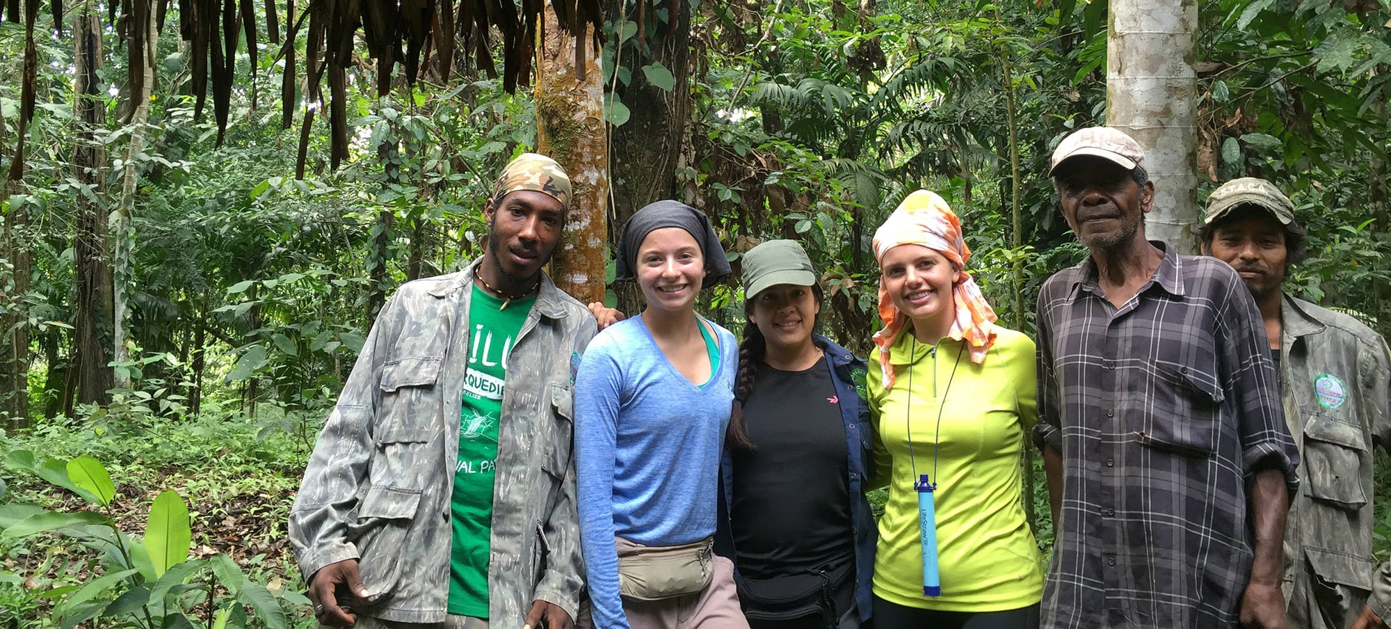 Redding and Kelsey Johnson with their guides at a jungle campsite