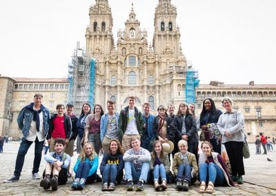 the group poses for a photo in front of the cathedral.